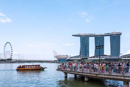 Singapore - April 12, 2015: Tourists visit Marina Bay Sands on evening.