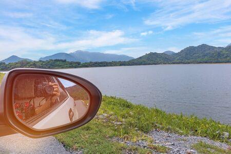Take natue landscape photo  with window car.
