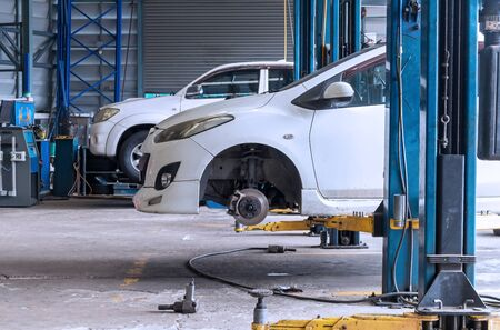 Maintenance car repair and tire change in the car fix center.