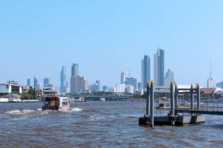 Bangkok, Thailand - December 5, 2019: View of boat on Chao Phraya River near Wat Rakhang Khositaram port. Redakční