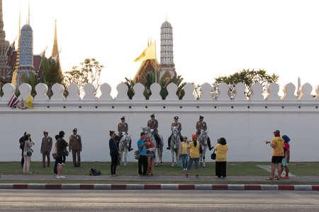 Bangkok, Thailand - December 5, 2019: Thai people take photo with cavalry near Wat Phra Kaew.