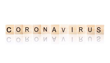 Corona virus word on wooden blocks  with reflection effect on white Isolated background. Reklamní fotografie
