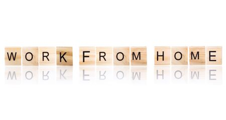 Work from home word on wooden blocks  with reflection effect on white Isolated background.