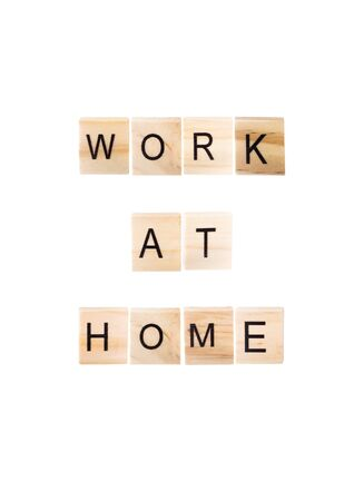 Work at home word on wooden blocks on white Isolated background. Reklamní fotografie