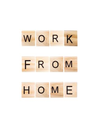 Work from home word on wooden blocks on white Isolated background.