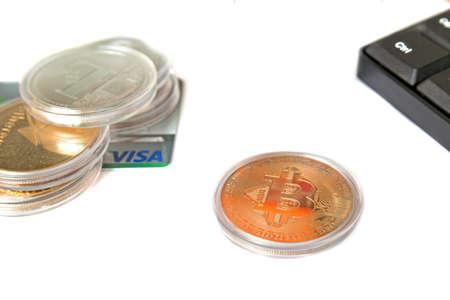 Bangkok, Thailand - March 17, 2018: Golden bitcoin and others on visa credit card with computer keyboard . Redakční