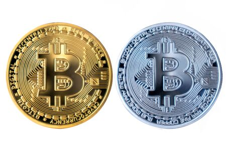 Golden Bitcoin with silver on white isolated background. Reklamní fotografie