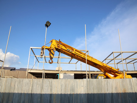 maneuverable: Industrial Crane operating and blue sky