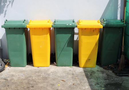 trashcan: Green and Yellow Trashcan Stock Photo