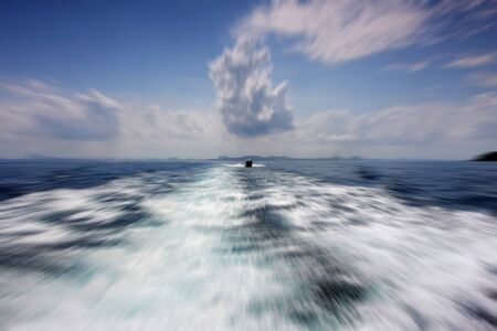 zooming: Radial motion blur  zooming effect  about the sea in a clear sky day Stock Photo