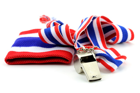 whistleblower: standless whistle and blue  with Thailand national flag lanyard in heart shape on white background