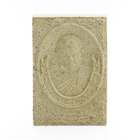 outworn: close up of Small buddha image used as amulet on the white background