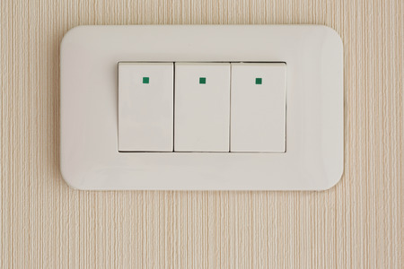 Press turn onoff electrical switch on the wallpaper