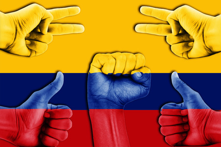 colombia flag: hands on Colombia flag background