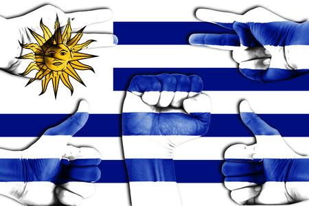 bandera de uruguay: manos en Uruguay fondo de la bandera Foto de archivo
