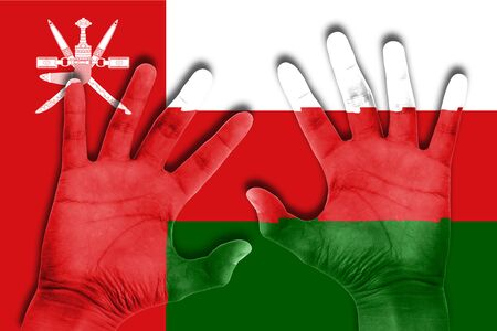 oman background: hands on oman flag background