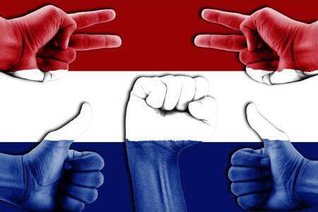 netherlands flag: hands on Netherlands flag background Stock Photo