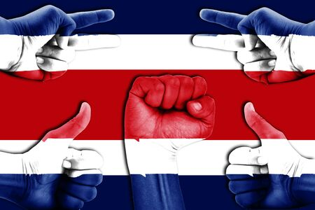 costa rica flag: hands on Costa Rica flag background Stock Photo