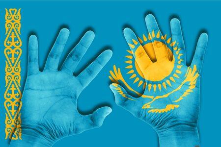 kazakhstan: hands on kazakhstan flag background