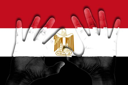 egypt flag: hands on egypt flag background Stock Photo