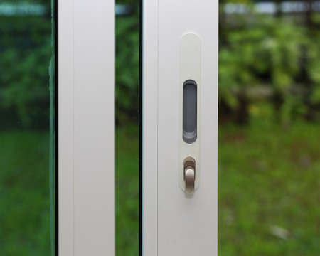 glass door: Locking or unlocking glass door Stock Photo