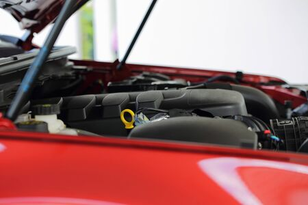red sports car: close up The cars engine hood open Viewed from the side Stock Photo