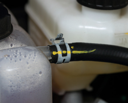 coolant: The cable locked Coolant in new car Stock Photo