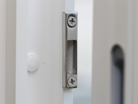 locking up: close up of window shutter locking device Stock Photo