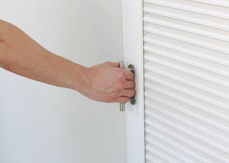 room door: hand close the door of storage room