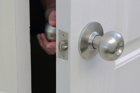 doorknob: Hand are opened doorknob from the inside home
