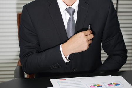 began: Businessman put a pen to pocket before the meeting began