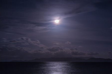 fool moon: Full moon with clouds and sky over the sea Stock Photo