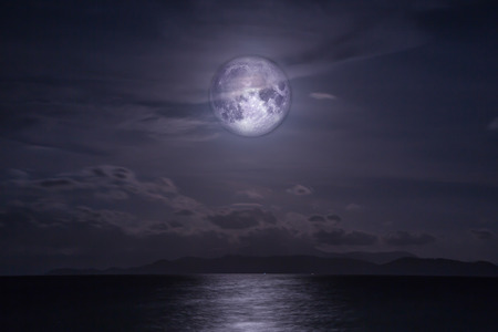 fool moon: Full moon over the sea. Elements of this image furnished by NASA