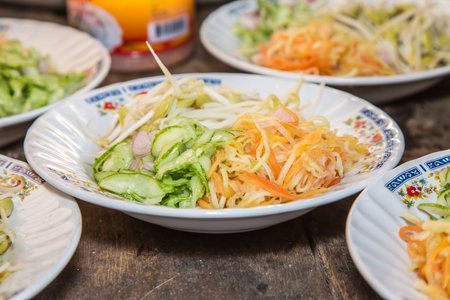 sprout: Side dish Vegetable consit papaya, cucumber, carrot and sprouts. Stock Photo