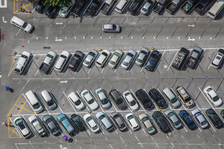 Car parking lot viewed from above, bird eye view