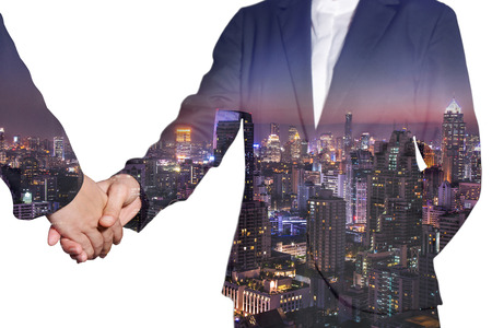 Double exposure of business women handshake and night city as commitment concept.
