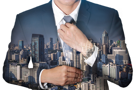 in readiness: Business  man held necktie dress to look good and city on daytime as Readiness concept.