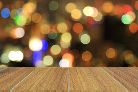 scabrous: Wooden top on background of blurred night bokeh - can used for display or montage your products