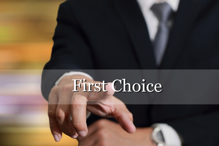 rated: Businessman hand touching First Choice sign on virtual screen as Good Options concept.
