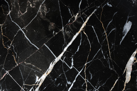 intrinsic: Patterns of black marble that occurs naturally use for background, texture and design.