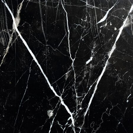 intrinsic: Detailed structure of black marble in natural patterned for background, texture and design product.