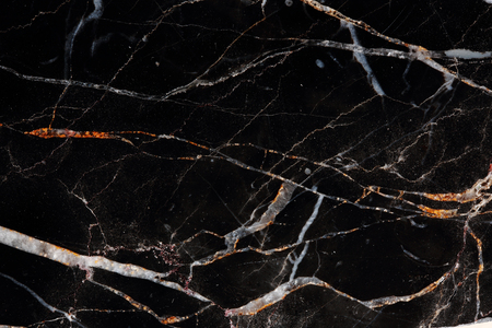 Patterned of black marble for texture, background and design. Abstract texture.