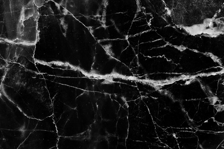 intrinsic: Natural pattern of black and white marble texture and background.
