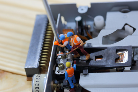 cd rom: Selective focus of miniature engineer and worker fixed and repair cd rom of computer and use for business background.