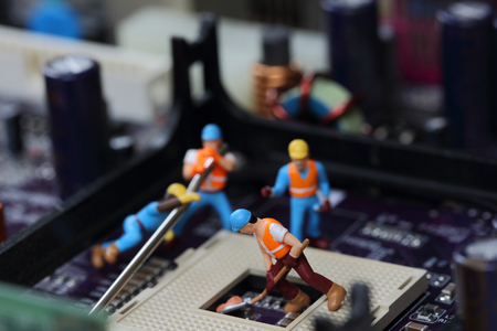 Selective focus of miniature engineer and worker fixed and repair CPU processor,  mainboard computer and use for business background.