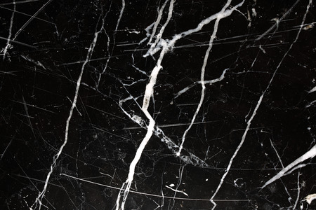 intrinsic: Patterned structure of black marble pattern (Black Italy) for design. Abstract marble background.