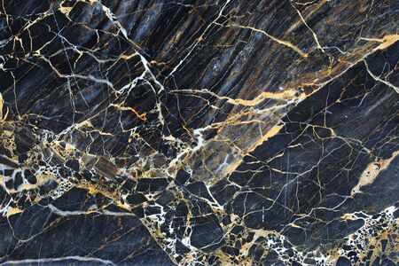 intrinsic: Gold patterned natural of dark marble pattern background texture.