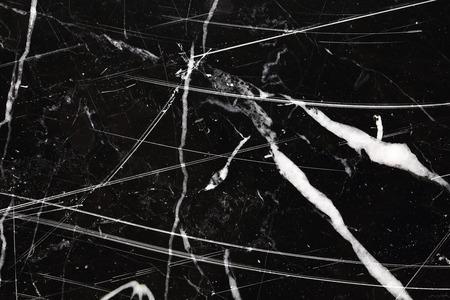 intrinsic: Black marble pattern texture. Stock Photo