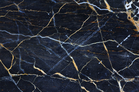 intrinsic: Gold yellow patterned natural in dark gray marble texture for design.