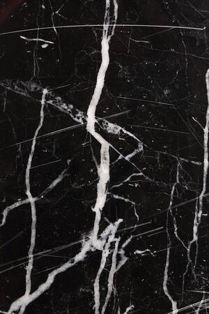 intrinsic: White pattern on black marble texture background. Stock Photo